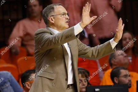 Stock Picture of Oklahoma head coach Lon Kruger gestures to his team in the second half of an NCAA college basketball game against Oklahoma State in Stillwater, Okla