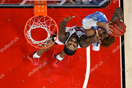 North Carolina forward Armando Bacot (5) shoots over Louisville forward Malik Williams (5) during an NCAA college basketball game, in Louisville, Ky. Louisville won 72-55