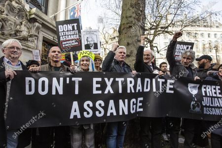 Stock Image of Don't Extradite Assange' protest march in London,Don't Extradite Assange' protest march from Australia House to Parliament Square in London. Participants include former Greek Minister of Finance and co-Founder DiEM25 Yanis Varoufakis, co-founder of Pink Floyd Roger Waters, Brian Eno, Chrissie Hynde, and fashion designer Vivienne Westwood.