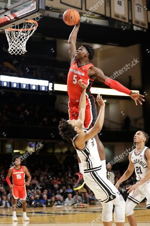Georgia guard Anthony Edwards (5) drives over Vanderbilt's Braelee Albert in the first half of an NCAA college basketball game, in Nashville, Tenn