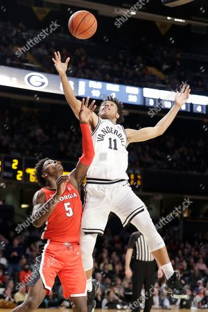 Vanderbilt's Braelee Albert (11) and Georgia guard Anthony Edwards (5) reach for a rebound in the second half of an NCAA college basketball game, in Nashville, Tenn