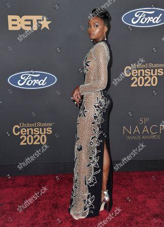 KiKi Layne arrives at the 51st NAACP Image Awards at the Pasadena Civic Auditorium, in Pasadena, Calif