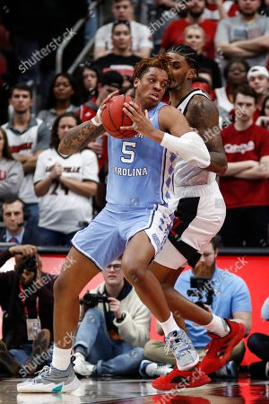North Carolina forward Armando Bacot (5) works for a shot against Louisville forward Malik Williams (5) during the second half an NCAA college basketball game, in Louisville, Ky. Louisville won 72-55