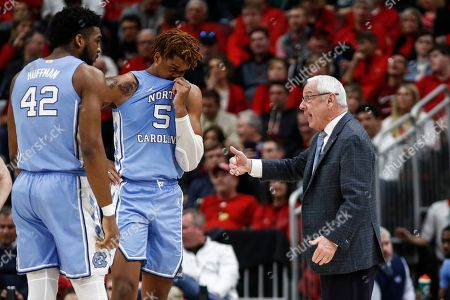North Carolina head coach Roy Williams talks to forward Armando Bacot (5) and forward Brandon Huffman (42) during the second half an NCAA college basketball game against Louisville, in Louisville, Ky. Louisville won 72-55
