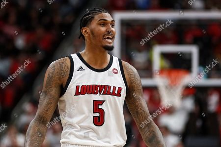 Louisville forward Malik Williams (5) smiles as he walks off the court during the second half an NCAA college basketball game against North Carolina, in Louisville, Ky. Louisville won 72-55