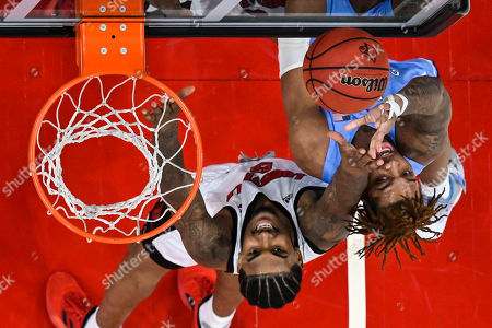 North Carolina forward Armando Bacot (5) goes for a rebound against Louisville forward Malik Williams (5) during an NCAA college basketball game, in Louisville, Ky. Louisville won 72-55