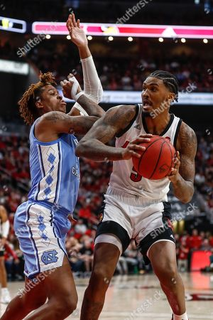Louisville forward Malik Williams (5) works for a shot against North Carolina forward Armando Bacot (5) during the second half an NCAA college basketball game, in Louisville, Ky. Louisville won 72-55