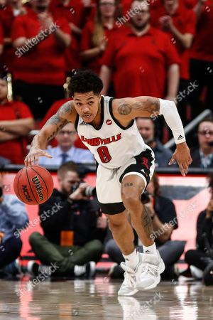 Louisville guard Lamarr Kimble (0) drives the ball up court during the second half an NCAA college basketball game against North Carolina, in Louisville, Ky. Louisville won 72-55