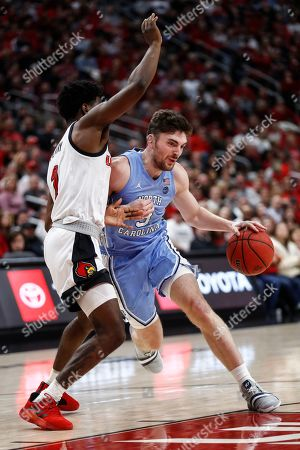 North Carolina guard Andrew Platek (3) drives past Louisville guard Lamarr Kimble (0) during the first half of an NCAA college basketball game, in Louisville, Ky