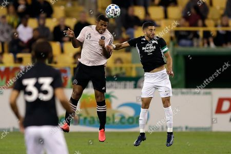 Inter Miami FC's Roman Torres (29) plays a header in front of Tampa Bay Rowdies' Sebastian Guenzatti during the first half of a preseason friendly soccer match, in St. Petersburg, Fla