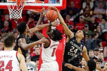 DJ Funderburk, Rayquan Evans, Devin Vassell. North Carolina State's DJ Funderburk (0) has his shot blocked by Florida State's Devin Vassell (24) and Patrick Williams (4) during the second half of an NCAA college basketball game in Raleigh, N.C