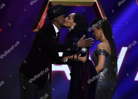 """J.B. Smoove, Tracee Ellis Ross, Robin Thede. J.B Smoove, left, embraces Tracee Ellis Ross, center, after she wins the award for outstanding actress in a comedy series for """"Black-ish"""" at the 51st NAACP Image Awards at the Pasadena Civic Auditorium, in Pasadena, Calif. Robin There looks on"""