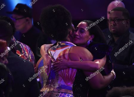 Lizzo, Tracee Ellis Ross. Lizzo, left, embraces Tracee Ellis Ross in the audience at the 51st NAACP Image Awards at the Pasadena Civic Auditorium, in Pasadena, Calif