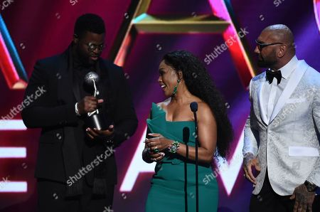 Winston Duke, Angela Bassett, Dave Bautista. Winston Duke, from left, presents the award for outstanding actress in a drama series to Angela Bassett, center, as Dave Bautista, right, looks on at the 51st NAACP Image Awards at the Pasadena Civic Auditorium, in Pasadena, Calif