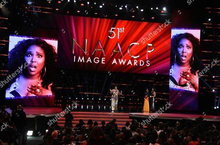 Lizzo wins the entertainer of the year award at the 51st NAACP Image Awards at the Pasadena Civic Auditorium, in Pasadena, Calif