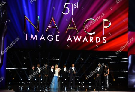 "Tim Blake Nelson, Jamie Foxx, Rob Morgan, Asher Goldstein, Brie Larson, Michael B. Jordan, Bryan Stevenson, Morgan Freeman. Tim Blake Nelson, from left, Jamie Foxx, Rob Morgan, Asher Goldstein, Brie Larson, Michael B. Jordan, and Bryan Stevenson win the award for outstanding motion picture for ""Just Mercy"" at the 51st NAACP Image Awards at the Pasadena Civic Auditorium, in Pasadena, Calif. Morgan Freeman looks on from stage right"