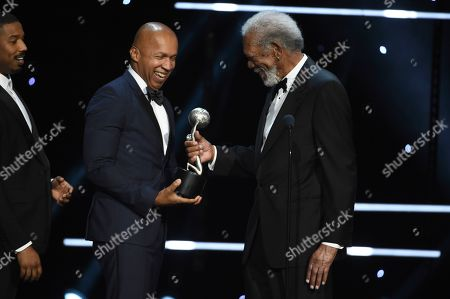 """Morgan Freeman, Bryan Stevenson. Morgan Freeman, right, presents Bryan Stevenson with the award for outstanding motion picture for """"Just Mercy"""" as Michael B. Jordan looks on from left at the 51st NAACP Image Awards at the Pasadena Civic Auditorium, in Pasadena, Calif"""