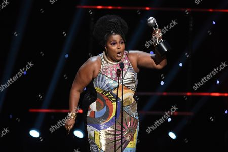 Lizzo wins the award for entertainer of the year at the 51st NAACP Image Awards at the Pasadena Civic Auditorium, in Pasadena, Calif