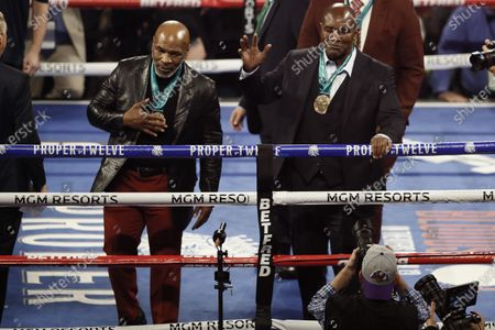 Former Heavyweight Champions Mike Tyson (L) and Evander Holyfield (R) acknowlege the crowd after they were honored before the main event, the WBC World Heavyweight Championship title fight between Deontay Wilder of the USA and Tyson Fury of Britain, at the Garden Arena in Las Vegas, Nevada, USA, 22 February 2020.