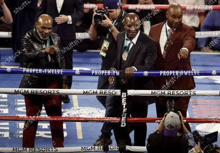 Former Heavyweight Champions Mike Tyson (L), Evander Holyfield (C), and Lennox Lewis (R) acknowlege the crowd after they were honored before the main event, the WBC World Heavyweight Championship title fight between Deontay Wilder of the USA and Tyson Fury of Britain, at the Garden Arena in Las Vegas, Nevada, USA, 22 February 2020.