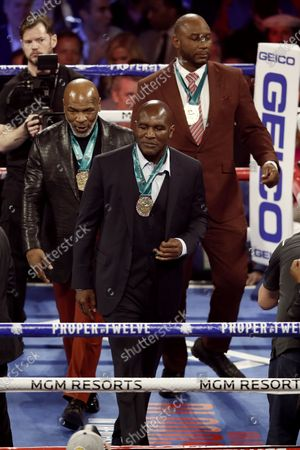 Former Heavyweight Champions Mike Tyson (L), Evander Holyfield (C), and Lennox Lewis (R) are honored before the main event, the WBC World Heavyweight Championship title fight between Deontay Wilder of the USA and Tyson Fury of Britain, at the Garden Arena in Las Vegas, Nevada, USA, 22 February 2020.