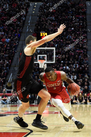 Amauri Hardy, Yanni Wetzell. UNLV guard Amauri Hardy (3) plays against San Diego State forward Yanni Wetzell (5) during the second half of an NCAA college basketball game, in San Diego. UNLV won 66-63