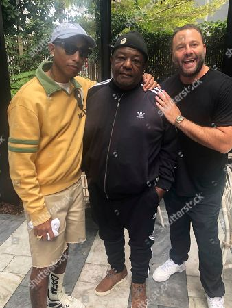 Pharrell, Pharaoh Williams, David Grumman. Grammy award winning singer Pharrell, from left, poses with his father Pharaoh Williams and nightlife guru David Grumman at the Swan restaurant in Miami's design district, . The singer hosted a soul food brunch Saturday along with his father who is a self-taught chef, as part of the South Beach Wine & Food Festival