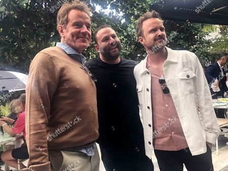 Bryan Cranston, David Grumman, Aaron Paul. Breaking bad actors Bryan Cranston, left, and and Aaron Paul, right, pose for a photo with nightlife guru David Grumman, center, at the Swan restaurant in Miami's design district, They were at a soul food brunch Saturday hosted by Grammy Award winning singer Pharrell, that was part of the South Beach Wine & Food Festival