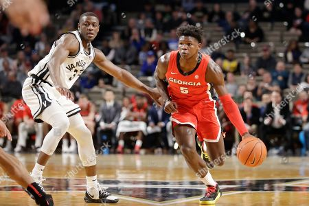 Georgia guard Anthony Edwards (5) drives against Vanderbilt guard Maxwell Evans (3) in the first half of an NCAA college basketball game, in Nashville, Tenn