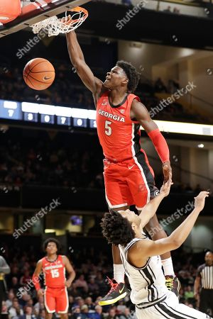 Georgia guard Anthony Edwards (5) dunks the ball against Vanderbilt in the first half of an NCAA college basketball game, in Nashville, Tenn