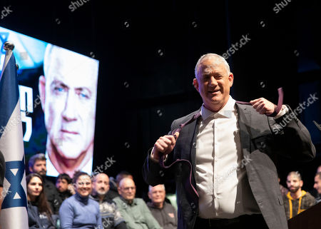 Benny Gantz, Blue and White party leader, takes off his tie during an election campaign event of his Blue and White party in Haifa, Israel. Israel finds itself in a familiar place after a tumultuous election campaign, with iconoclastic politician Avigdor Lieberman seemingly in control of the country's fate. Opinion polls ahead of the March 2 vote show that neither Prime Minister Benjamin Netanyahu nor Gantz will be able to form a coalition government without him. Lieberman remains cagey about his intentions, raising the possibility his brinkmanship could end up forcing yet another election