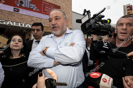 Avigdor Lieberman, center, leader of the Yisrael Beiteinu, party, meets people during election campaign tour in a shopping mall in the Port city of Ashdod, Israel. Israel finds itself in a familiar place after a tumultuous election campaign, with Lieberman seemingly in control of the country's fate. Opinion polls ahead of the March 2 vote show that neither Prime Minister Benjamin Netanyahu nor his challenger Benny Gantz will be able to form a coalition government without him. Lieberman remains cagey about his intentions, raising the possibility his brinkmanship could end up forcing yet another election