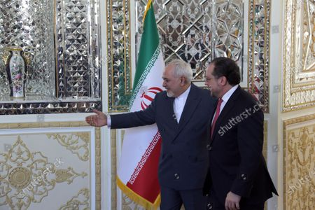 Stock Image of Iran's Foreign Minister Mohammad Javad Zarif (L) welcomes Austrian Foreign Minister Alexander Schallenberg (R) at the foreign ministry office in Tehran, Iran, 23 February 2020. Schallenberg is in Tehran to meet with Iranian officials.