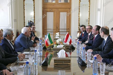 Stock Photo of Iran's Foreign Minister Mohammad Javad Zarif (2-l) and Austrian Foreign Minister Alexander Schallenberg (2-R) sit for a meeting at the foreign ministry office in Tehran, Iran, 23 February 2020. Schallenberg is in Tehran to meet with Iranian officials.