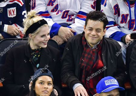 Lucy Boynton and Rami Malek attend San Jose Sharks vs New York Rangers game at Madison Square Garden