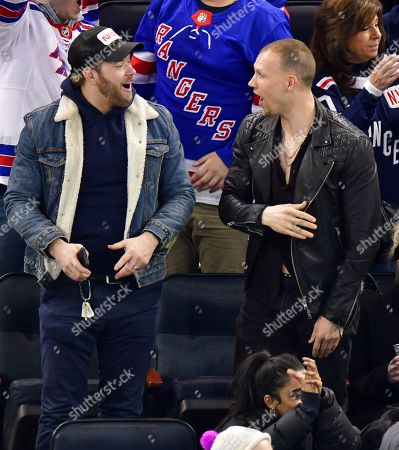 Stock Picture of Kellan Lutz and guest attend San Jose Sharks vs New York Rangers game at Madison Square Garden