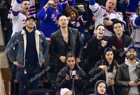 Kellan Lutz, guest, Lucy Boynton and Rami Malek attend San Jose Sharks vs New York Rangers game at Madison Square Garden