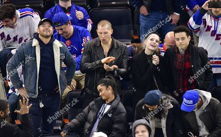Stock Image of Kellan Lutz, guest, Lucy Boynton and Rami Malek attend San Jose Sharks vs New York Rangers game at Madison Square Garden
