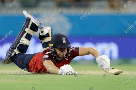 Stock Image of Katherine Brunt of England dives for her wicket during the Women's T20 World Cup cricket match between England and South Africa at the WACA Ground in Perth, Australia, 23 February 2020.