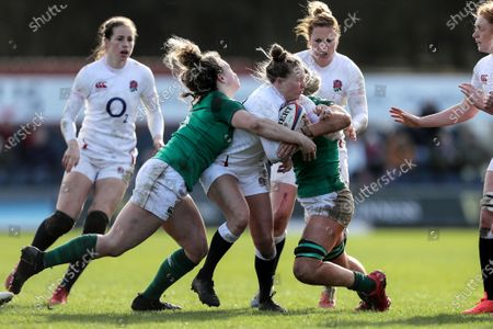 England Women vs Ireland Women. England's Emily Scott is tackled by Victoria Dabanovich O'Mahony and Ciara Cooney of Ireland