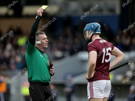 Waterford vs Galway. Galway's Conor Cooney receives a yellow card from referee James Owens
