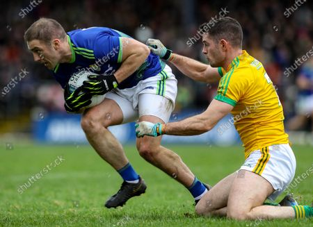 Kerry vs Meath. Kerry's Stephen O'Brien and Donal Keogan of Meath