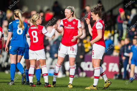 Jordan Hobbs (Capt) (Arsenal) congratulates Louise Quinn (Arsenal) and then Jennifer Beattie (Arsenal) during the Women's FA Cup match between Arsenal Women FC and Lewes Ladies FC at Meadow Park, Borehamwood