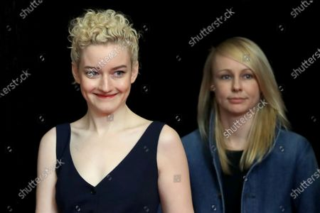 Julia Garner (L) and Director Kitty Green arrive for the 'The Assistant' photocall during the 70th annual Berlin International Film Festival (Berlinale), in Berlin, Germany, 23 February 2020. The movie is presented in the Panorama section at the Berlinale that runs from 20 February to 01 March 2020.