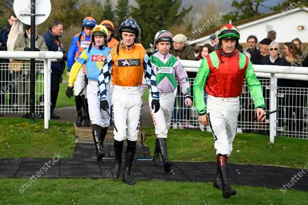 Stock Image of Jockey Leighton Aspell 2nd right enters the Parade Ring for the first of two rides before retiring during Horse Racing at Fontwell Park Racecourse on 23rd February 2020