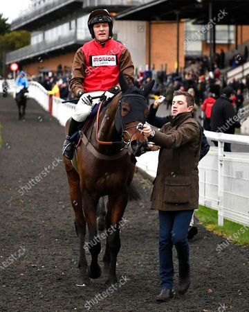 Stock Image of Winner of The Fairmile Snacks Open Hunters' Chase  Bob and Co ridden by David Maxwell and trained by Paul Nicholls  is led into the Winners enclosure during Horse Racing at Fontwell Park Racecourse on 23rd February 2020
