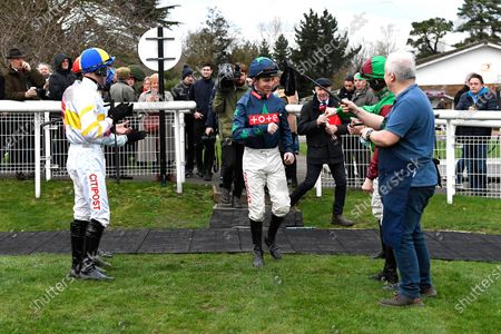 Jockey Leighton Aspell centre is clapped into the parade ring for his final race before retiring during Horse Racing at Fontwell Park Racecourse on 23rd February 2020