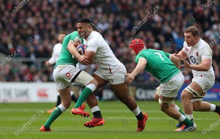 Manu Tuilagi of England crashes into Jonny Sexton of Ireland