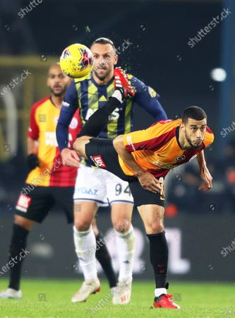 Fenerbahce's Vedat Muriqi (C) in action against Galatasaray's Younes Belhanda (front) during the Turkish Super League soccer derby match between Fenerbahce and Galatasaray in Istanbul, Turkey, 23 February 2020.