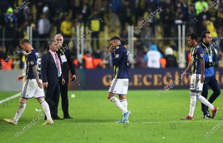Fenerbahce players (L-R) Serdar Aziz, Nabil Dirar, and Jailson react after the Turkish Super League soccer derby match between Fenerbahce and Galatasaray in Istanbul, Turkey, 23 February 2020.